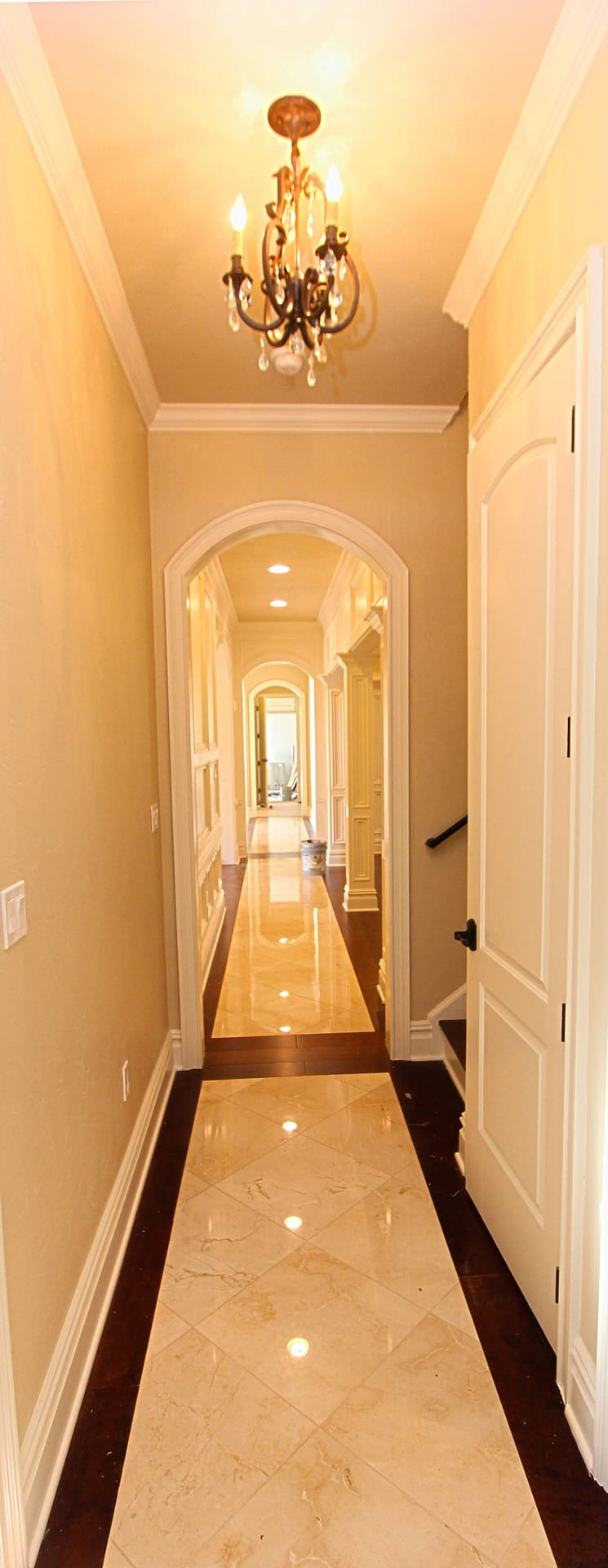 Country Club Estate Tiled Hallway with Chandelier